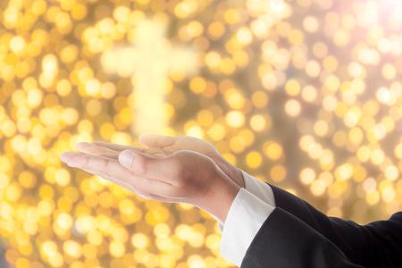 glorify: businessman pray with  cross light on hand. Stock Photo