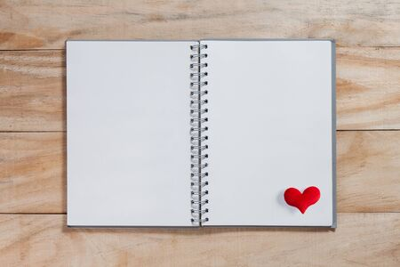 heart shaped stuff: notebook with red heart on wood table ,Valentines background