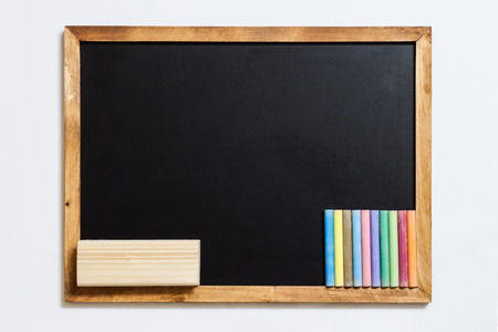 white chalks: Blank blackboard with colorful chalks and eraser on white background