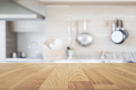 Wood table top with blur kitchen background , empty wooden table for product display