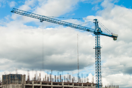 paesaggio industriale: Industrial landscape with cranes on blue sky