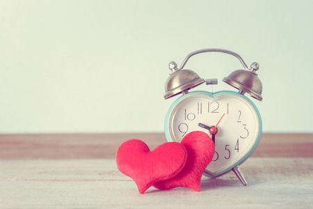 heart alarm clock and heart shape on table, Valentines Day background Stock Photo