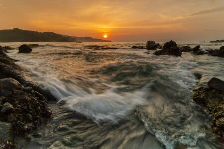 Sawarna Beach is a hidden paradise which  a great looking sunset and sunrise Фото со стока
