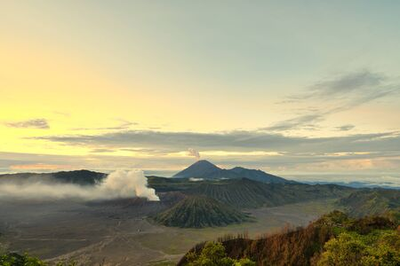 Waiting for the golden sunset on the beautiful volcano mountain Фото со стока