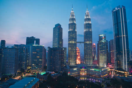 Caption : Kuala Lumpur, Malaysia - March 30, 2019 : Visit the Petronas Tower as one of the tallest buildings in the world to watch the splendid sunset at dusk