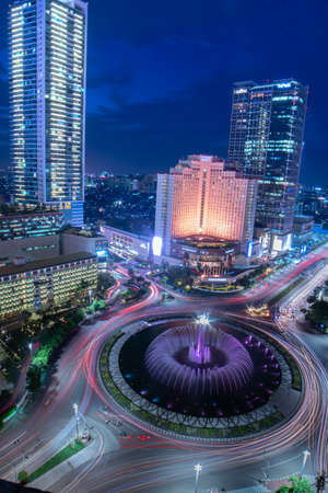 Jakarta, Indonesia - March 6, 2019 : Perfect spot to enjoy Bundaran HI view, especially with your beloved people at the night