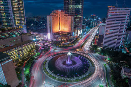Jakarta, Indonesia - March 6, 2019 : The famous Jakarta's landmark, Bundaran HI and you can enjoy the beautiful night view from your apartment