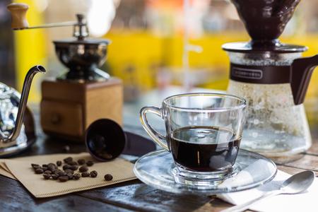 black beans: Black coffee and coffee beans, Coffee bean grinder, Drip coffee. Stock Photo