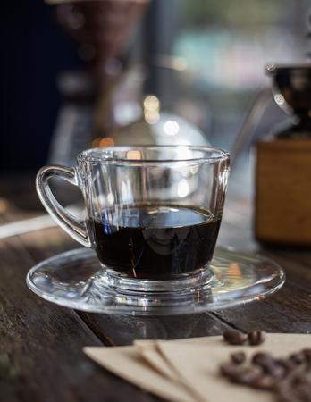 Black coffee and coffee beans, Coffee bean grinder, Drip coffee. Stock Photo