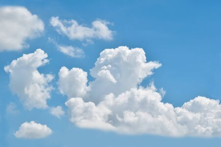 Blue sky with clouds. Nature background.