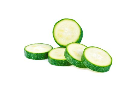 fresh green zucchini slices isolated on white background