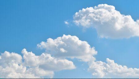 Blue sky with white clouds. Фото со стока
