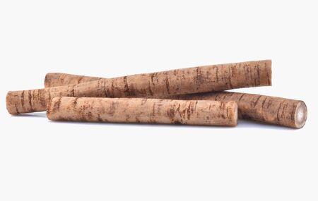 Fresh Burdock roots on white background Фото со стока