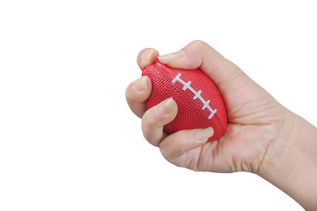 Hand squeezing stress ball .Physical , emotional stress therapy