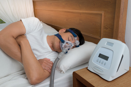 Sweet dream during long deep sleep.Continuous positive airway pressure  ,CPAP sleep apnea therapy.Happy and healthy senior man  breathing more easily during sleep without snoring . Stock Photo