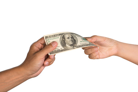 corrupt: Close up of males hand giving money to females hand. Hands passing money,US dollar currency,isolated white background with clipping path