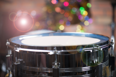 Blurred snare drum Snare drum ,steel shell,blurred on stand with multicolour bokeh blurred background Stock Photo