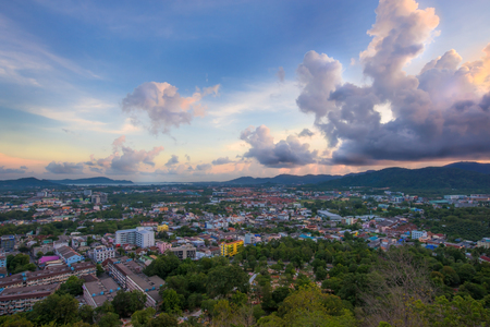 High angle view from Kao Rang mountain view point.  Monsoon clouds over phuket town after sunset.