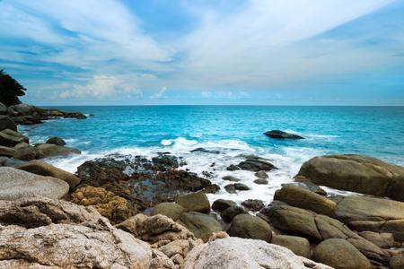 Big wave impacting the rock on coastline . Beautiful seascape of Kata beach ,Phuket with blue cloudy sky. Stock Photo