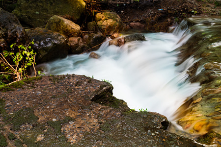 日の出、長時間露光で滝の風景です。 常に Salika の滝、Nakornnayok、タイで流れ下り、旅行先を水します。 写真素材