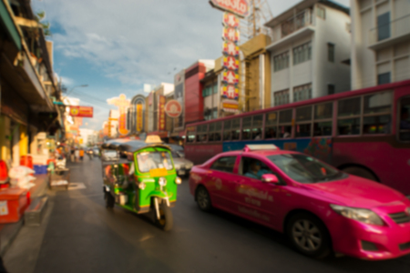 BANGKOK-JULY 15,2017:Yaowarat china town one of the famous tourist destination of Thailand. Tuk Tuk  on the golden  street  at sunset ,  blur for background.