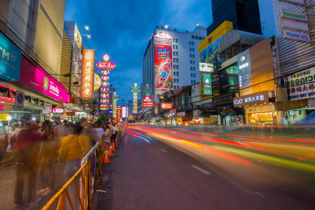 BANGKOK-JULY 15,2017:Yaowarat china town one of the famous travel destination of Thailand. Light trail on the golden street at night with crowd of people ,motion blur. Редакционное
