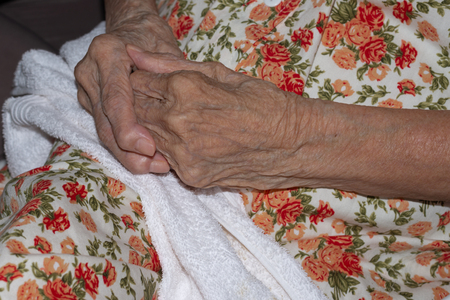 Close up hands of healthy woman aged over 90 joining together,side view. Hands of love.