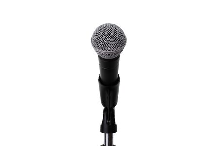 Close up of microphone setting on stand isolated on white background with clipping path.   Dynamic microphone on stage .