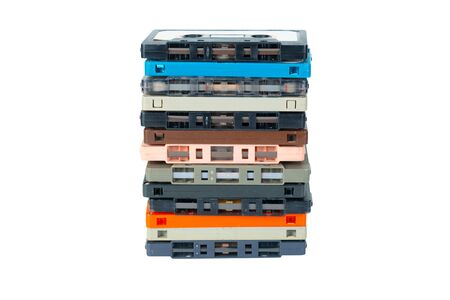 Obsolete technology of audio recording and playback format audio cassette tape isolated on white background with clipping path. Cassette tapes stack tower .