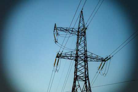 High-voltage line with wires against a blue sky