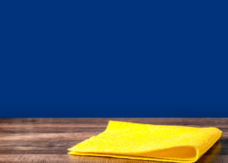 Napkin yellow on the kitchen table blue background Stok Fotoğraf
