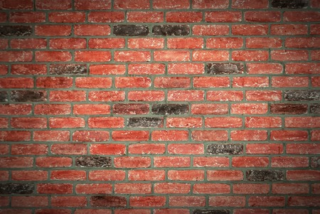Brick wall with texture in red colors for background and wallpaper.