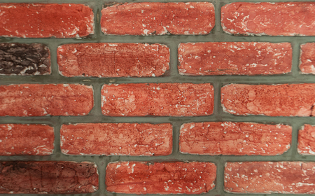 Brickwork with a beautiful texture in red colors for the background. Banco de Imagens