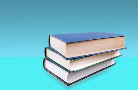 books stacked on top of each other and blue background Stok Fotoğraf