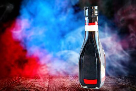 bottle of soy sauce isolated on black with clipping path