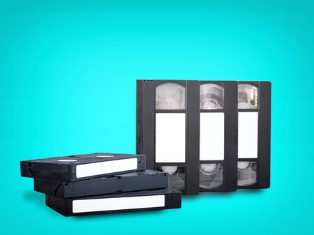 VHS videotapes on a blue background folded vertically and horizontally stand side by side.
