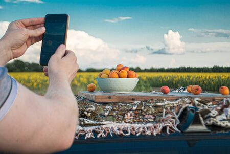 shooting fruit on a mobile phone against the backdrop of nature