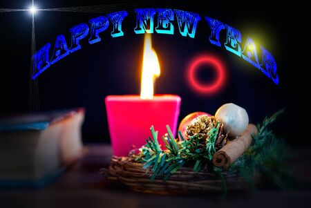 burning candle christmas wreath for postcard happy new year