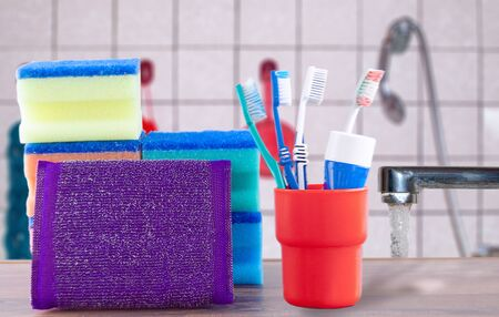 toothbrushes toothpaste and washcloths on the background of the bathroom