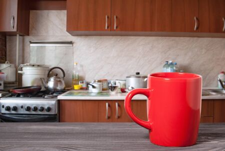 wooden surface and mug on the background of the kitchen Stok Fotoğraf