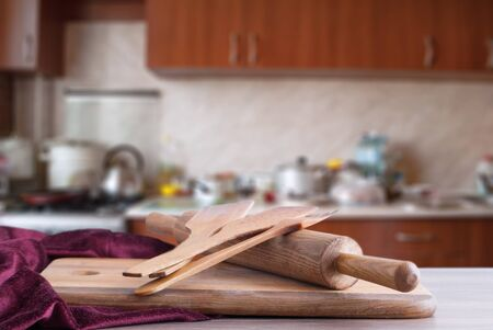 wooden surface and inventory on the background of the kitchen