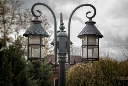 Street city night lanterns in retro style in cloudy weather.
