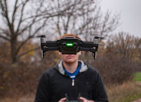 quadrocopter flying in the air against the background of a person with a remote control Stok Fotoğraf
