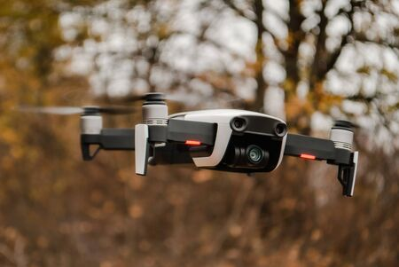 quadcopter hanging in the air on a blurred background Stok Fotoğraf