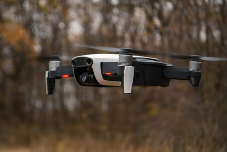 quadrocopter hanging in the air above the ground