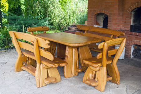 Handmade wooden furniture for a summer house table and benches