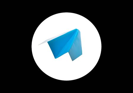 Blue paper airplane in a white circle on a black background