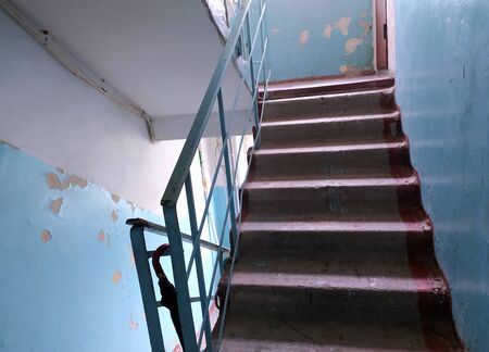 Staircase at the entrance of a multi-storey building without repair