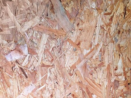 Texture of pressed wood sawdust for backgrounds and wallpapers