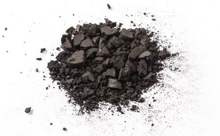 Activated carbon powder isolated on white. Health concept